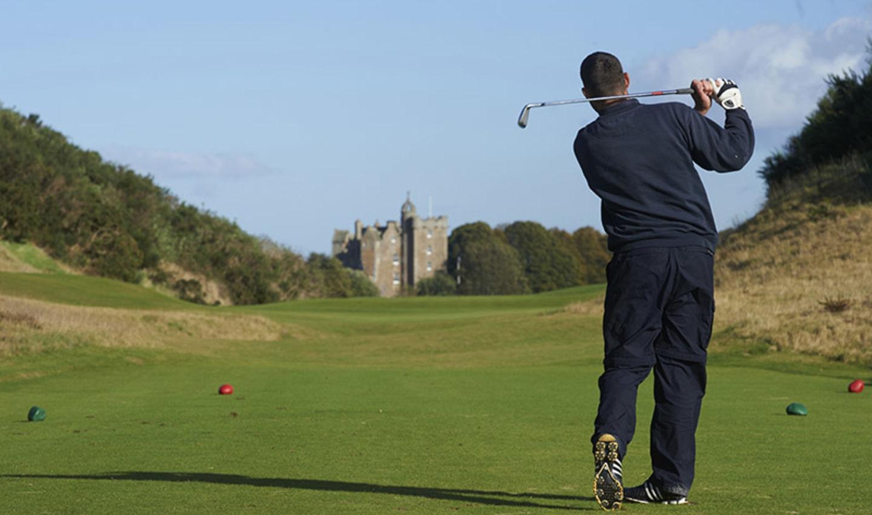 Golfer playing at Castle Stuart golf club