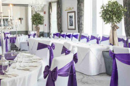A room set up for a wedding at Kingsmills Hotel
