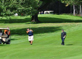 Men playing golf.