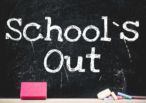 School's Out written on black chalk board