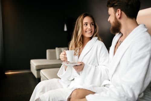 Couple drnking tea in bathrobes