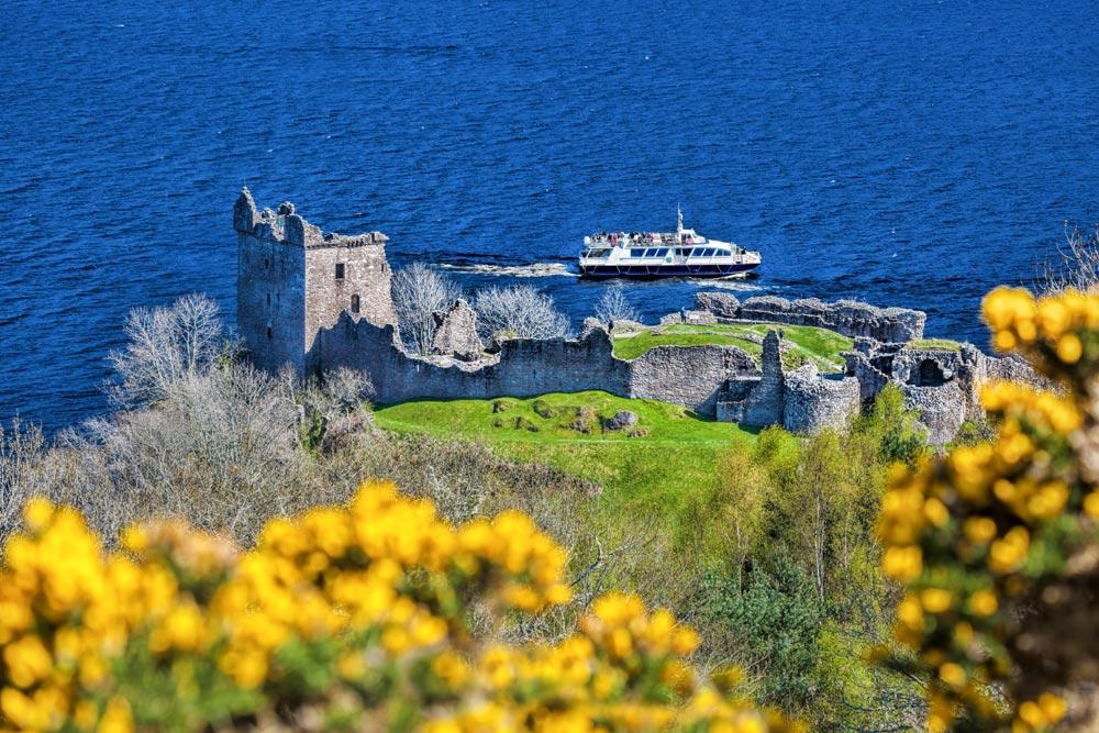 Boat on Loch Ness near Urquhart Castle