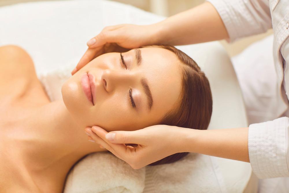 Woman having a spa facial treatment
