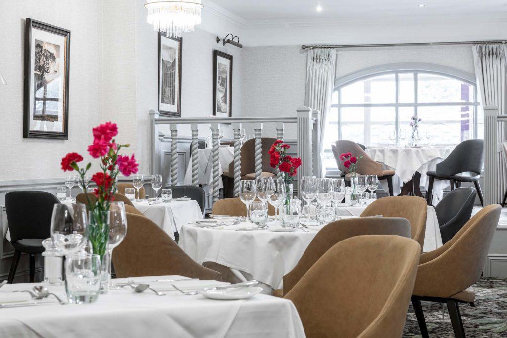 Restaurant with tables set for dinner