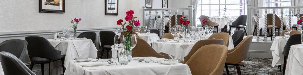 The Inglis Restaurant set for dining at Kingsmills Hotel