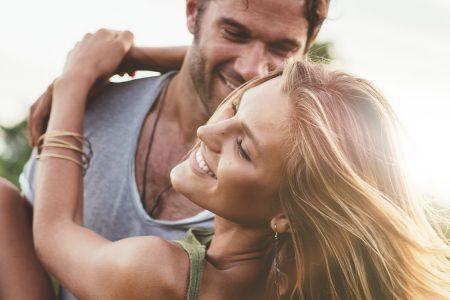a man and woman having fun in the sun