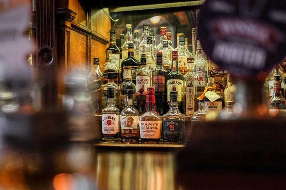 Bottles of whisky behind a bar